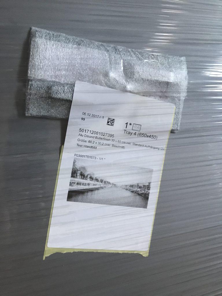 Saal Digital Wandbild Verpackung